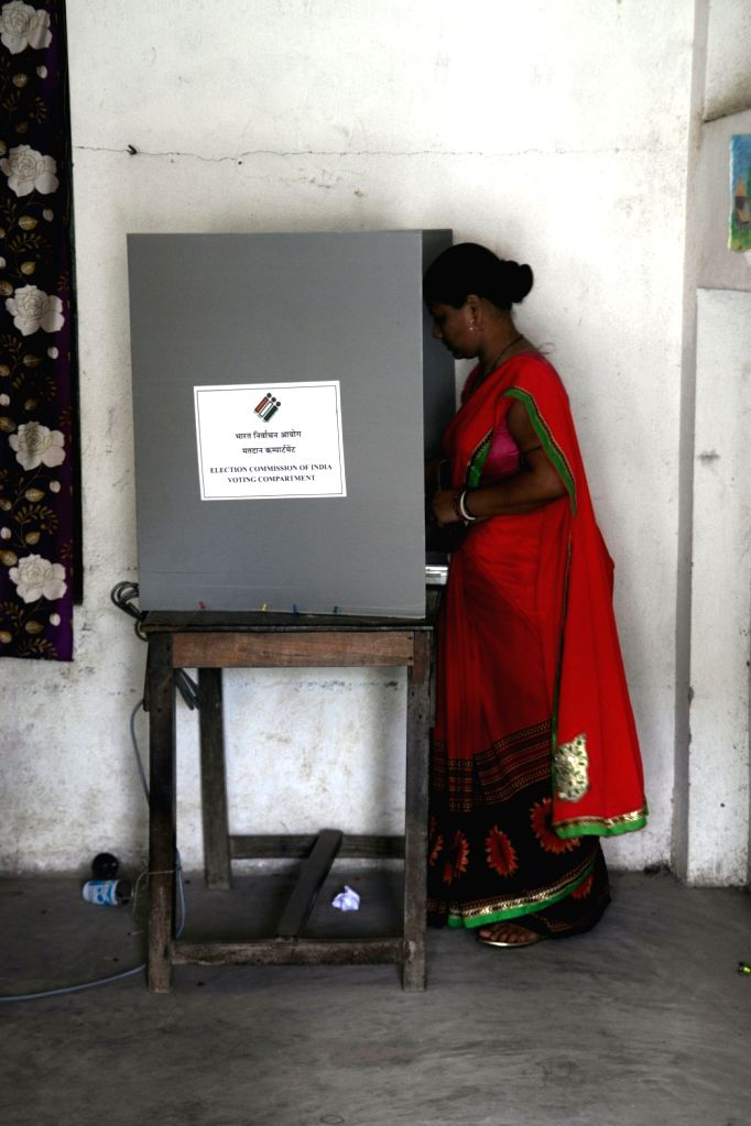 A woman casts vote during the sixth phase of 2019 Lok Sabha polls, in West Bengal's Midnapore, on May 12, 2019.