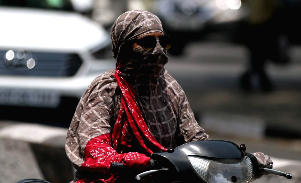 A woman cover her face so as to avoid scorching sun in Chennai on May 20, 2017.