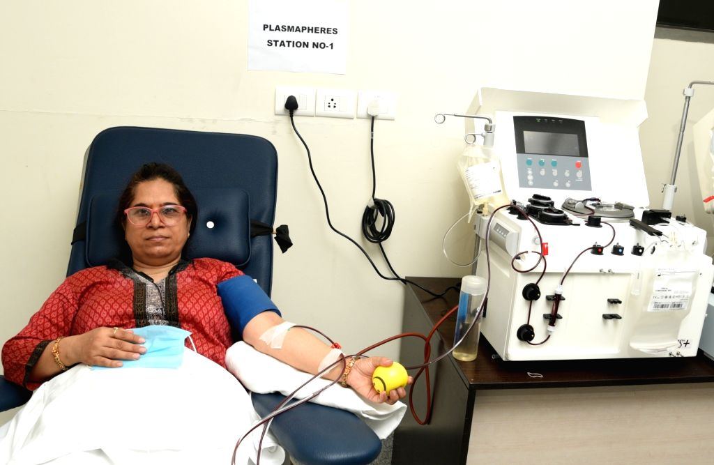 A woman donates plasma at India's first plasma bank set up at the Institute of Liver and Biliary Sciences (ILBS) Hospital, in New Delhi on July 10, 2020.