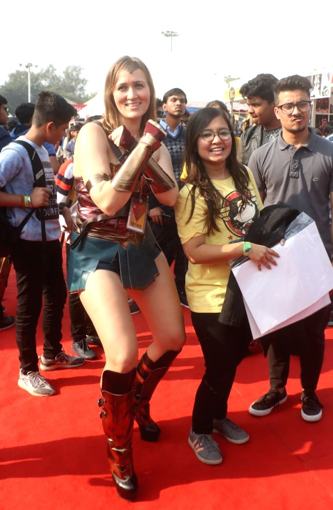 """A woman dressed up as fictional superhero """"Wonder Woman"""" at the three-day fest - """"Comic Con"""" in New Delhi on Dec 8, 2018."""
