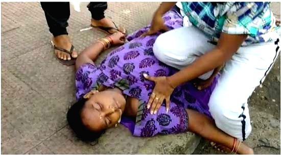 A woman frothing at her mouth lays unconscious after the gas leakage at the LG Polymers unit located at RR Venkatapuram near Gopalapatnam in Visakhapatnam, Andhra Pradesh that left one ...