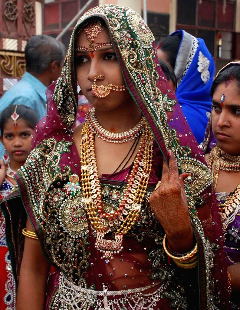 A woman in traditional attire during Bonalu festival celebrations at Dhoolpet of Hyderabad on July 7, 2014.