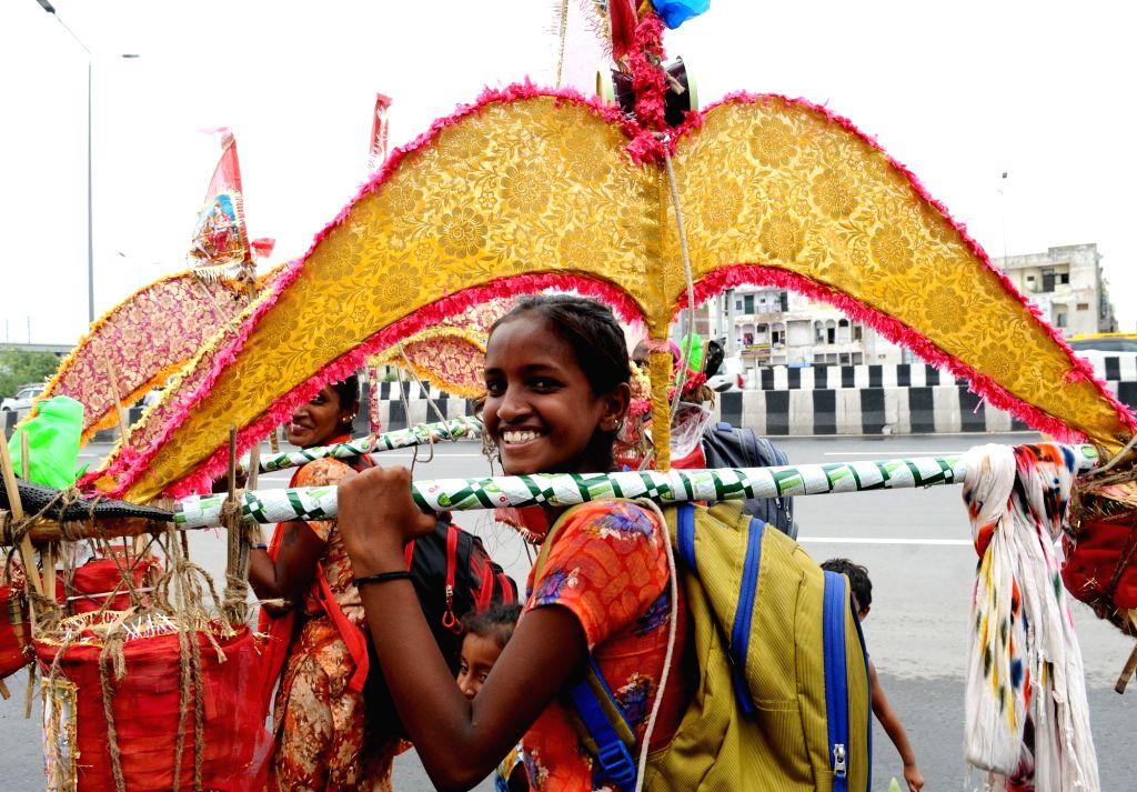 A woman kanwariya during her return journey from Haridwar, in New Delhi on July 26, 2019.