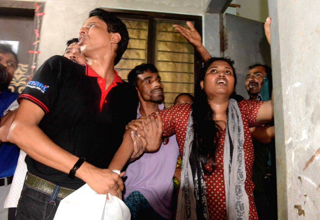 A woman mourns as her husband was stabbed to death at their residence in Dhaka, Bangladesh, Aug. 7, 2015. Unidentified attackers on Friday hacked a Bangladeshi secular ...