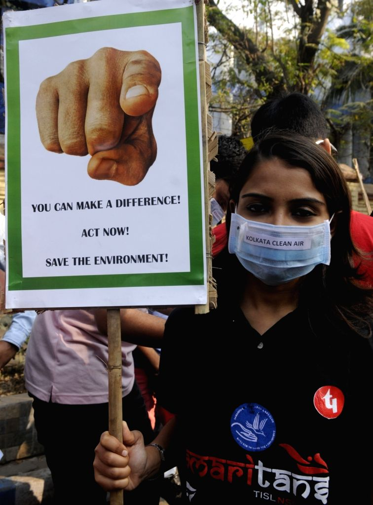 A woman participates in an awareness campaign against air pollution in Kolkata, on Jan 27, 2019.