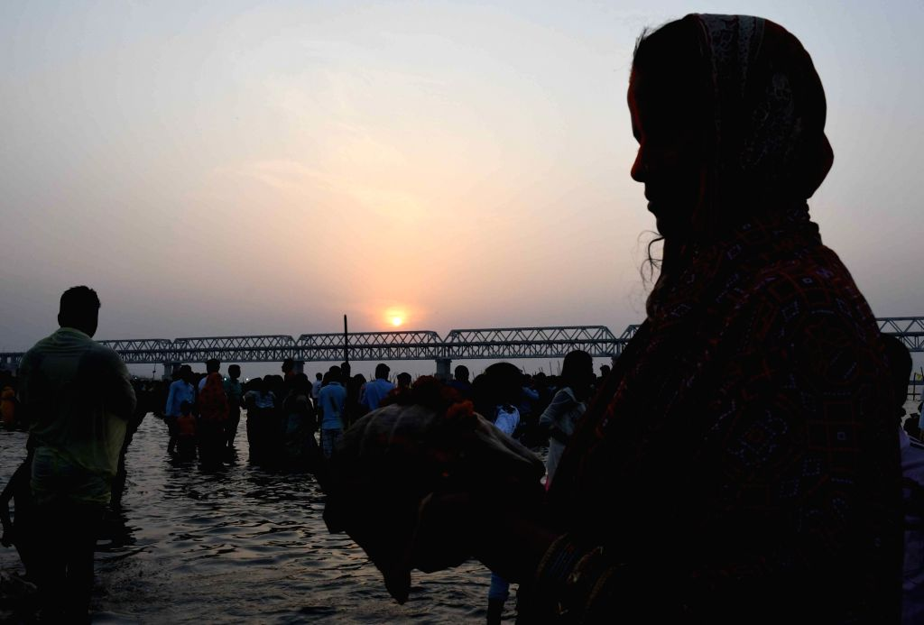 A woman performs rituals during Chaiti Chhath Puja celebrations, in Patna on April 11, 2019.