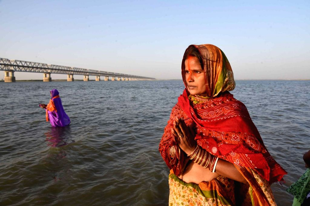 A woman performs rituals in the Ganga river during Chaiti Chhath celebrations amid countrywide lockdown imposed to contain the spread of novel coronavirus, in Patna on March 30, 2020.