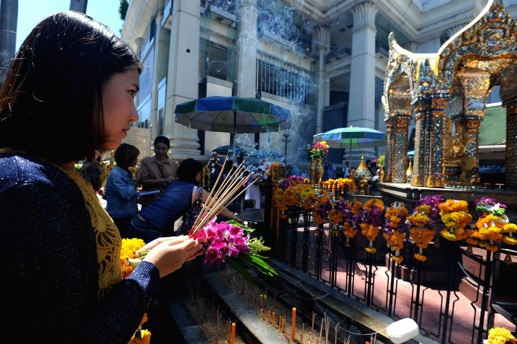 A woman prays at the Erawan Shrine at Rajprasong intersection in Bangkok, Thailand, Aug. 19, 2015. As the traffic at an intersection near the blasted Erawan Shrine ...