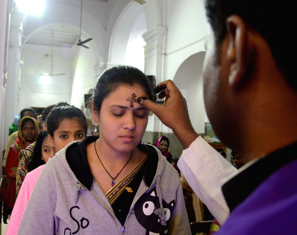 """A woman receives a cross of ashes during the traditional """"Ash Wednesday"""" in Bhopal on Feb 14, 2018."""