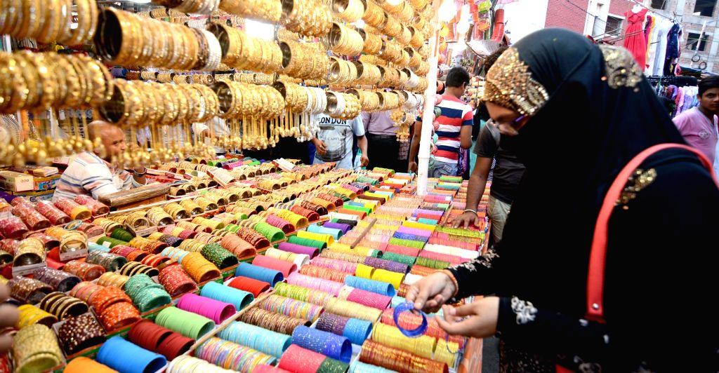 A woman seen busy shopping ahead of Eid, in Kolkata, on May 26, 2019.
