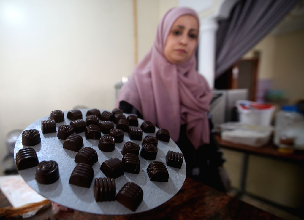 A woman shows homemade sweets ahead of the Eid al-Adha festival in the southern Gaza Strip city of Rafah, July 29, 2020.