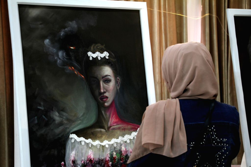 A woman visits Palestinian artist Kholoud El-Desouki's exhibition, describing the feelings of women in Gaza Strip, in Gaza City, Aug. 11, 2020. - Kholoud E