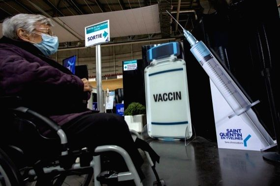 A woman waits to receive the COVID-19 vaccine in a COVID-19 vaccination center at the National Velodrome de Saint-Quentin-en-Yvelines in Saint-Quentin-en-Yvelines, France, on March 24, 2021.