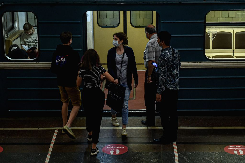 A woman wearing a face mask gets off a subway train at a station in Moscow, Russia, on July 13, 2020. Russia has registered 6,537 new COVID-19 cases in the last 24 ...