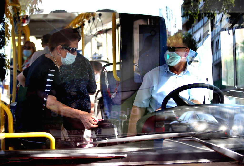 A woman wearing a face mask gets on a bus in Sibenik, Croatia, on June 25, 2020.