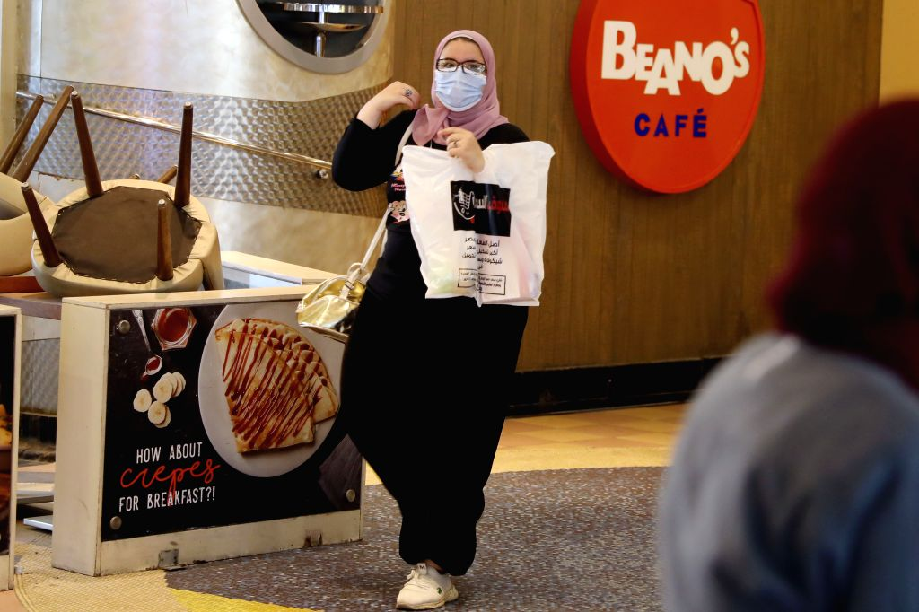 A woman wearing a face mask is seen in a shopping mall in Cairo, Egypt, on Aug. 7, 2020. Egypt registered on Friday 141 new COVID-19 cases, taking the total infections ...