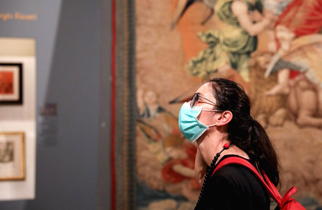 "A woman wearing a face mask visits the exhibition ""Raffaello 1520-1483"" in Rome, Italy, July 2, 2020. The ""Raffaello 1520-1483"" exhibition, the ..."
