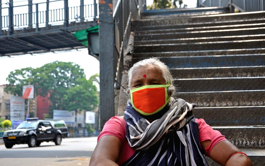 A woman wears a mask as a precautionary measure against COVID-19 on Day 2 of the 21-day nationwide lockdown imposed by the Narendra Modi government over the coronavirus pandemic; in Kolkata ... - Narendra Modi