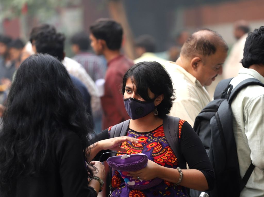 A woman wears a mask to protect herself from air pollution as air quality worsens in New Delhi on Nov 15, 2019.