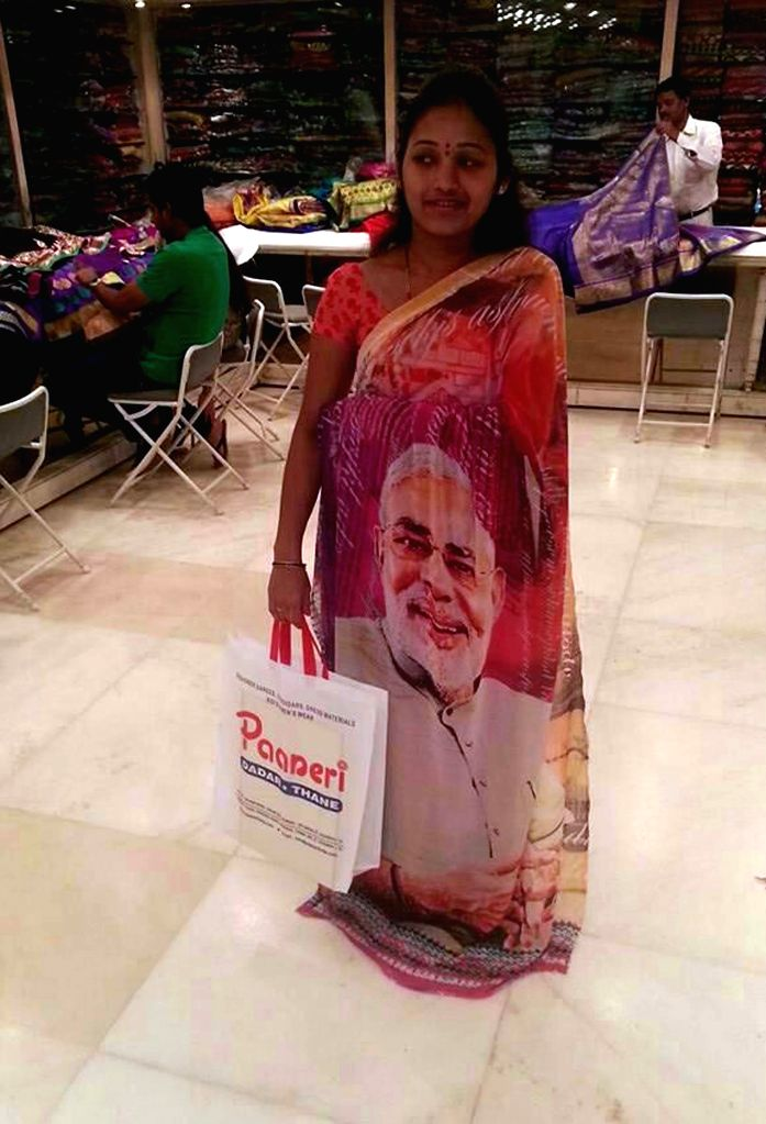 A woman wears a saree with a picture of BJP Prime Ministerial candidate and Gujarat Chief Minister Narendra Modi printed on it in Mumbai on May 15, 2014.