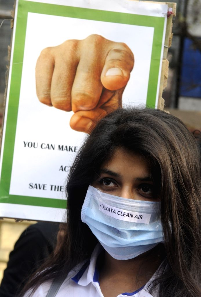 A woman wears pollution mask during an awareness campaign against air pollution in Kolkata, on Jan 27, 2019.