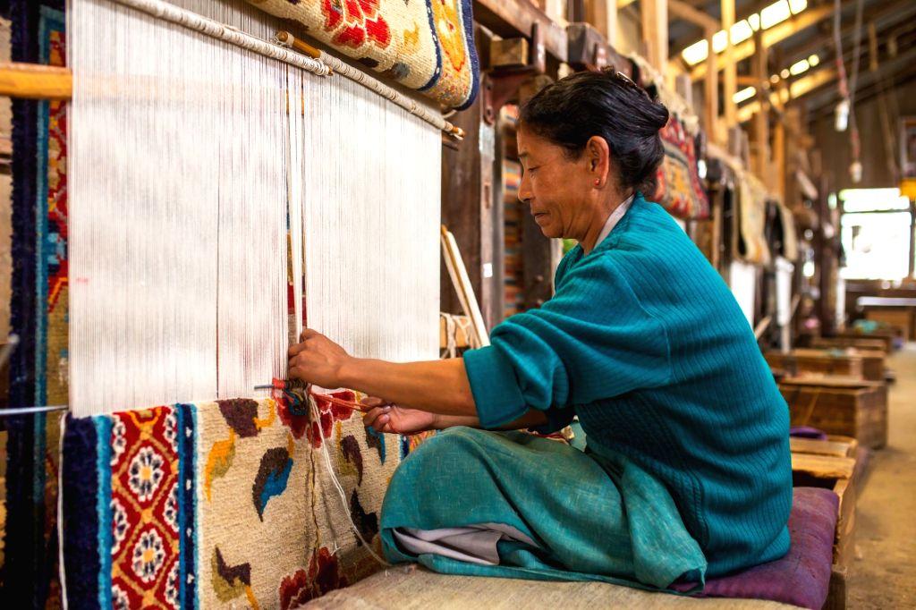 A woman weaver in Darjeeling, West Bengal. (Photo Courtesy: Shutterstock)