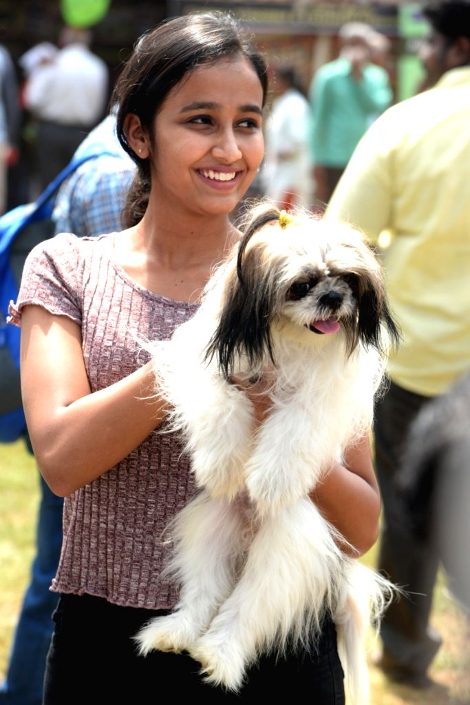 A woman with her pet during All India championship dog show organised by Silicon City Kennel Club, in Bengaluru on Nov 10, 2019.
