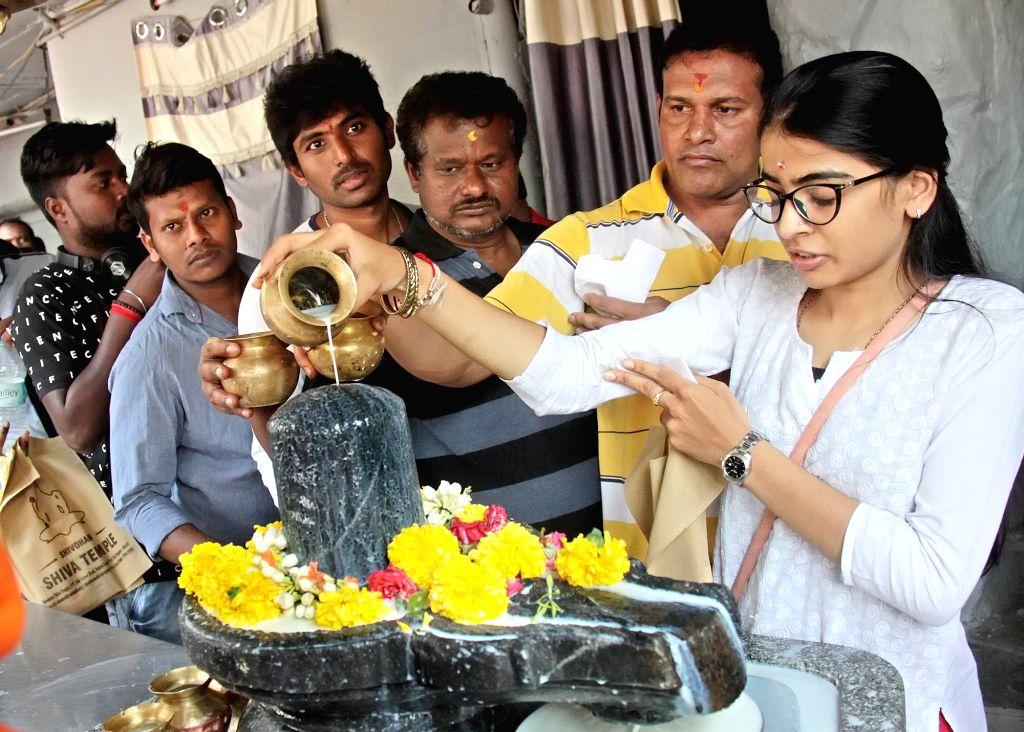 A woman worship Lord Shiva on Maha Shivratri at Shivoham Shiva Temple, in Bengaluru, on March 4, 2019.