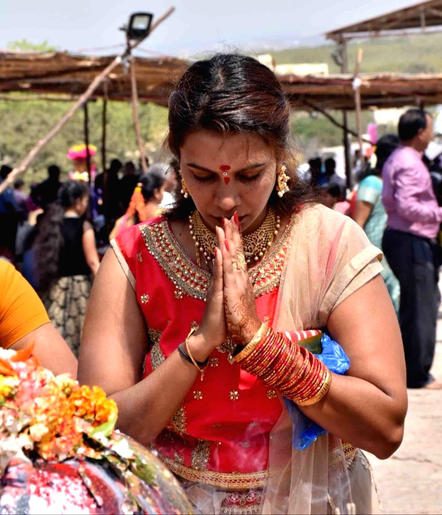 A woman worship Lord Shiva on Maha Shivratri at Keesaragutta Temple in Medchal-Malkajgiri district of Telangana on March 4, 2019.