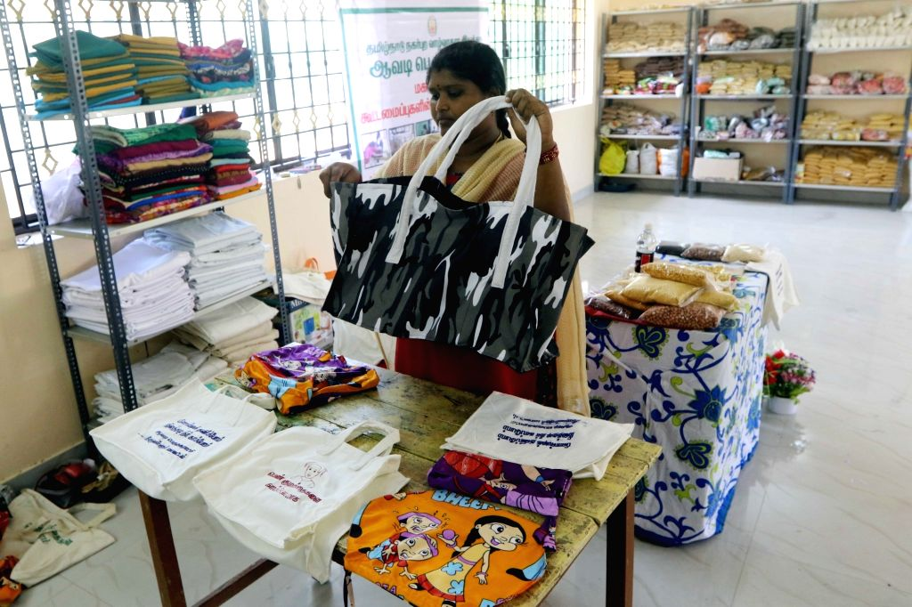 A worker assembles stitched biodegradable bags ahead of a plastic ban announced by the Tamil Nadu government, in Chennai on July 16, 2018. The state government recently issued orders that ...