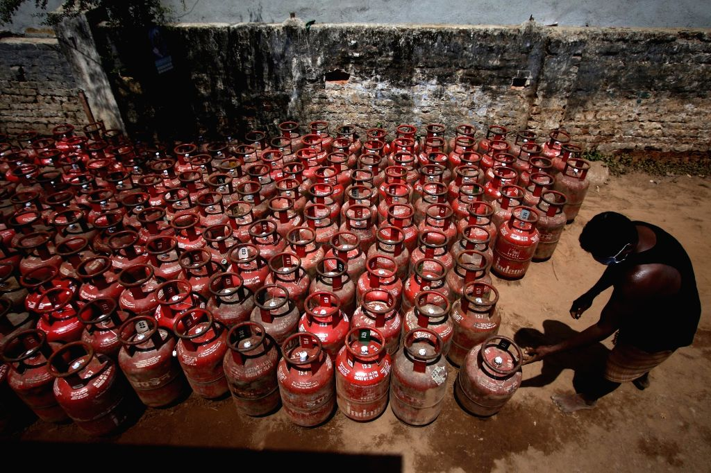 A worker busy arranging LPG Gas cylinders at a godown on Day 2 of the 21-day nationwide lockdown imposed by the Narendra Modi government over the coronavirus pandemic; in Chennai on March ... - Narendra Modi