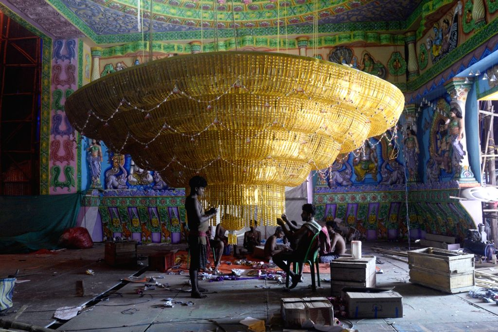 A worker busy decorating a pandal ahead of Durga Puja in Kolkata on Sept 18, 2017.