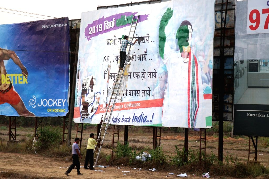 A worker busy removing political banner under the supervision of Election Commission of India (ECI) ahead of the 2019 Lok Sabha elections, in Fatorda, Goa, on March 13, 2019.