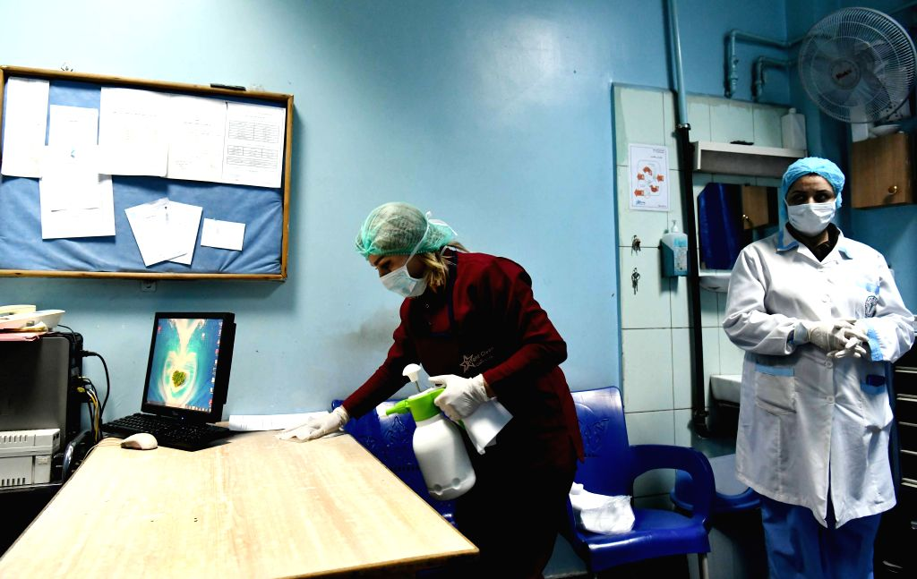 A worker cleans up in the government-run Mujtahid Hospital in Damascus, capital of Syria, on March 19, 2020. The Syrian authorities carry out daily cleaning ...