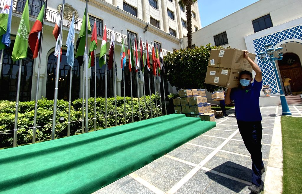 A worker delivers anti-coronavirus medial materials during a handover ceremony at the headquarters of Arab League in Cairo, Egypt, on July 5, 2020. The Cairo-based ...