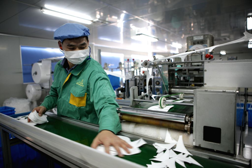A worker makes masks at Shanghai Dasheng Health Products Manufacturing Co., Ltd. in Shanghai