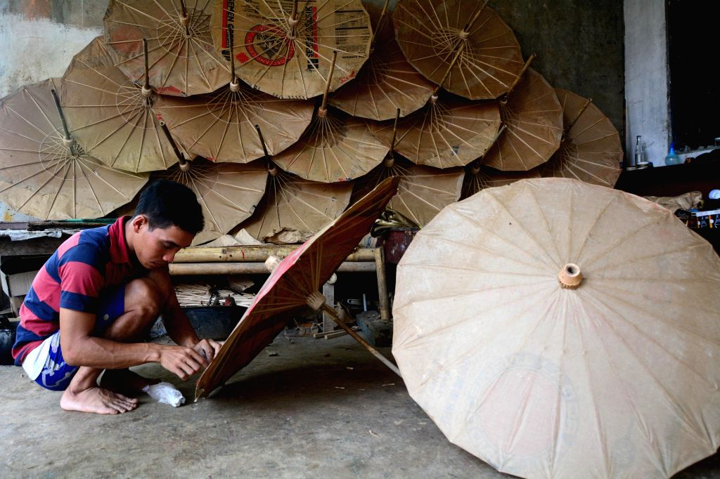 A worker makes paper umbrellas at Banyumas, Central Java, Indonesia, Nov. 27, 2015.