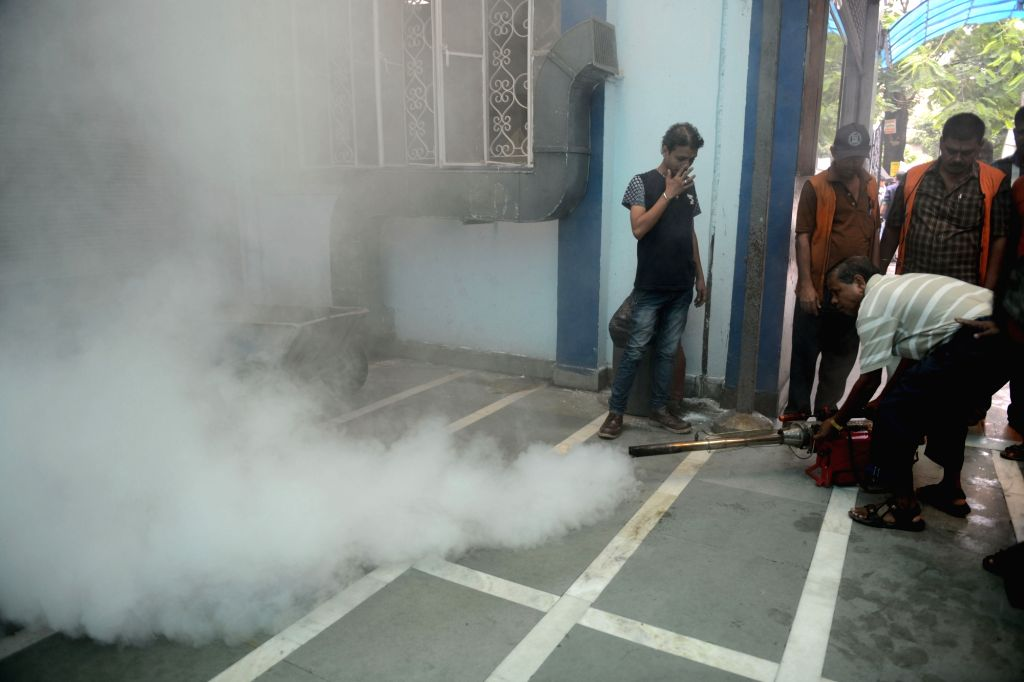 A worker sprays culicide to prevent dengue fever in Kolkata on Aug 6, 2016.