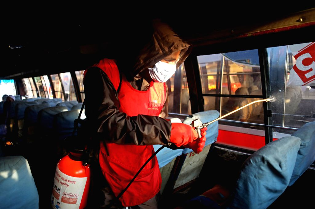 A worker sterilizes a bus in Dhaka, Bangladesh, on March 19, 2020. A total of 17 cases of COVID-19 have been confirmed in Bangladesh with three more testing positive ...