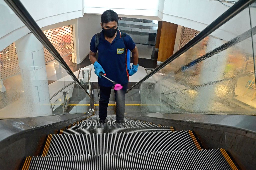 A workers sanitized at a shopping mall which will re-open tomorrow as the State Government announced relaxations on the ongoing lockdown during the coronavirus pandemic in Kolkata  on ...