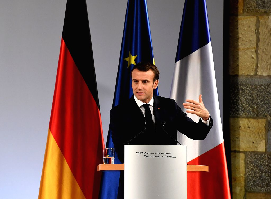 AACHEN, Jan. 22, 2019 - French President Emmanuel Macron delivers a speech at the treaty of Aachen signing ceremony in Aachen, Germany, on Jan. 22, 2019.  German Chancellor Angela Merkel and French ...