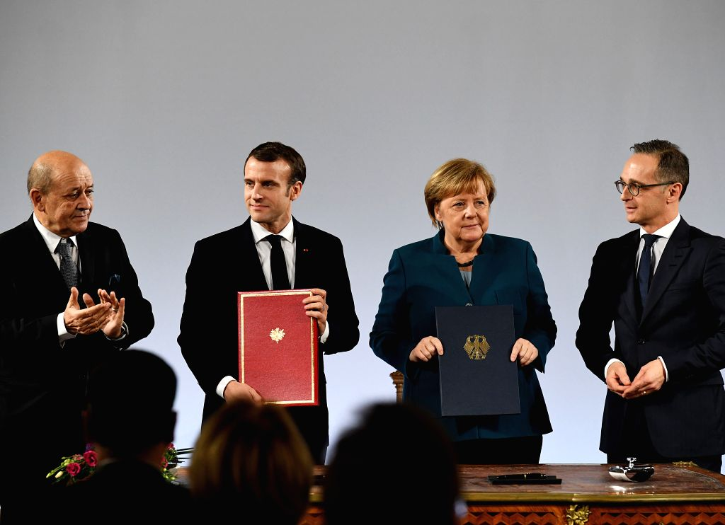 AACHEN, Jan. 22, 2019    German Chancellor Angela Merkel (2nd, R) and French President Emmanuel Macron (2nd, L) attend the treaty of Aachen signing ceremony in Aachen, Germany, on Jan. 22, ...