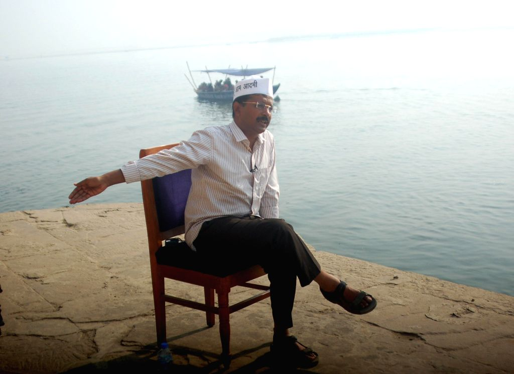 Aam Aadmi Party (AAP) leader Arvind Kejriwal interacts with media persons on the banks of Ganga river at Assi ghat of Varanasi on April 16, 2014.