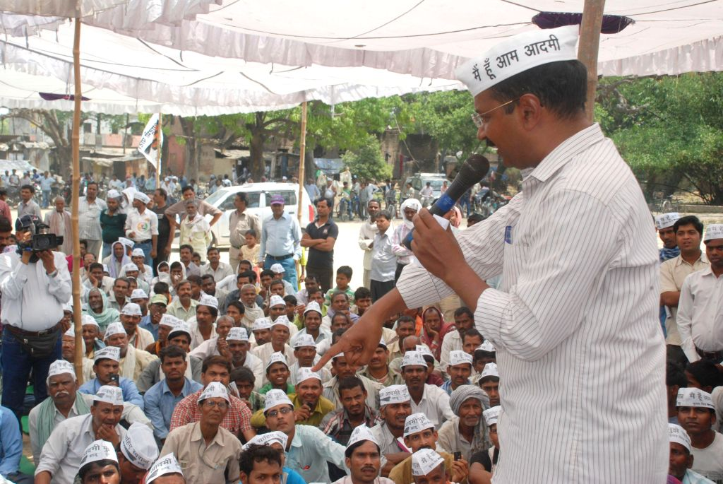 Aam Aadmi Party (AAP) leader Arvind Kejriwal addresses during a meeting at a village near Varanasi on April 16, 2014.