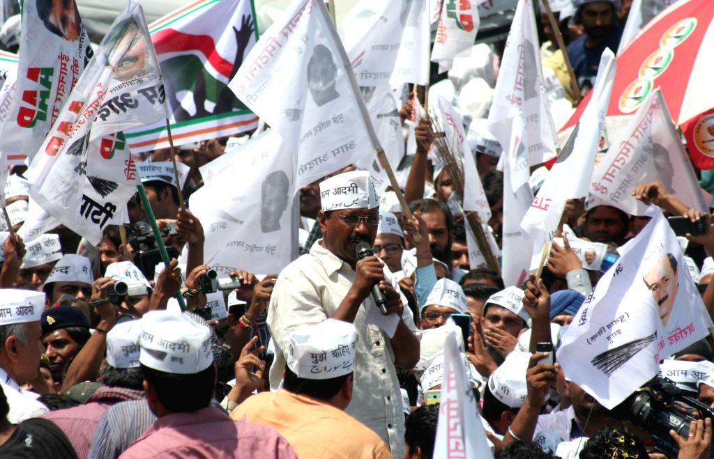 Aam Aadmi Party (AAP) leader Arvind Kejriwal addresses people ahead of filing his nominations from Varanasi Lok Sabha parliamentary constituency in Varanasi on April 23, 2014.