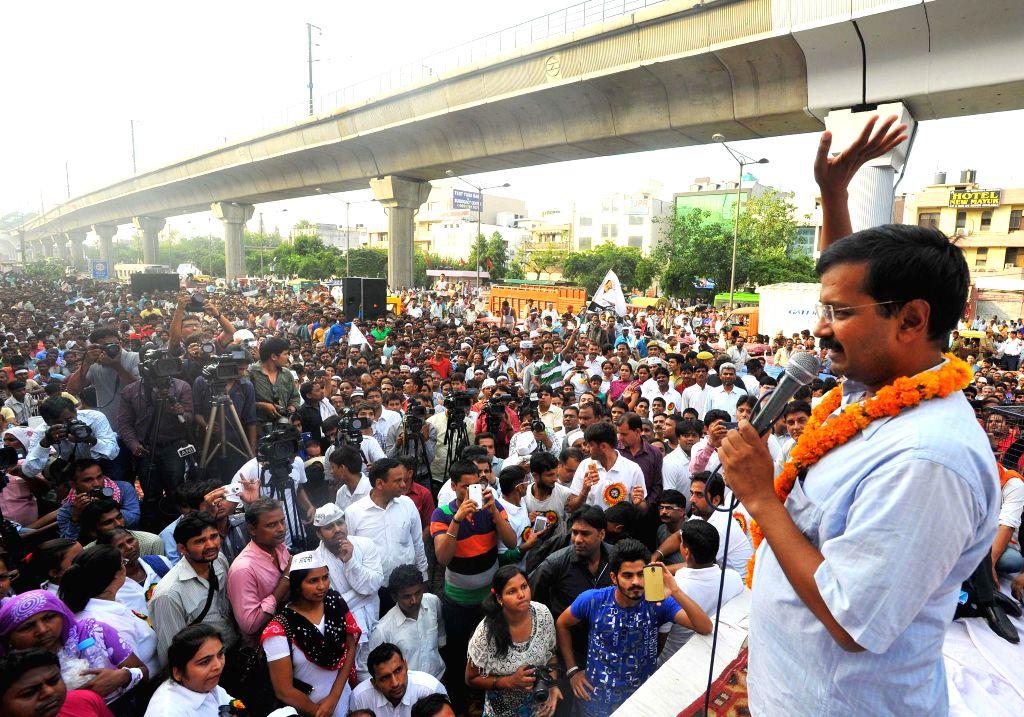 Aam Aadmi Party (AAP) leader Arvind Kejriwal addresses a rally organised by E-Rickshaw Association at Adarsh Nagar in New Delhi on June 22, 2014. - Arvind Kejriwal