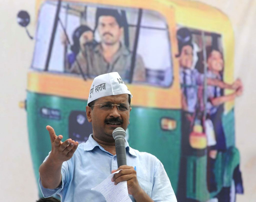 Aam Aadmi Party (AAP) leader Arvind Kejriwal addresses a rally organised by auto-drivers at Ramlila Maidan in New Delhi on July 31, 2014.