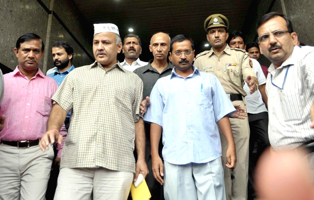 Aam Aadmi Party (AAP) leader Arvind Kejriwal and Manish Sisodia come out after meeting Delhi Police Commissioner B S Bassi in New Delhi on Sept 11, 2014. - Arvind Kejriwal