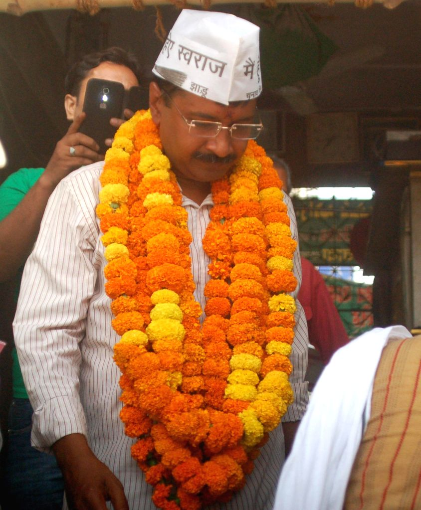 Aam Aadmi Party (AAP) leader Arvind Kejriwal comes out after visiting a mazzar during an election campaign in Varanasi on April 18, 2014.