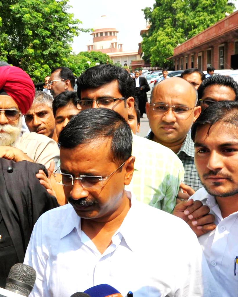 Aam Aadmi Party (AAP) leader Arvind Kejriwal talks to media as he comes out of the Supreme Court of India in New Delhi on Sept 9, 2014.